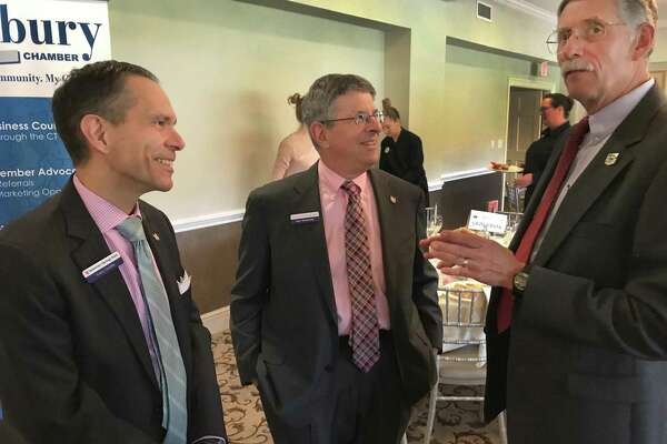 File photo. Economist Don Klepper-Smith, right, speaks with Tony Giobbi and Ken Weinstein of Newtown Savings Bank during the Greater Danbury Chamber of Commerce's 2018 Economic Forecast Breakfast held Tuesday, April 17, 2018, at Ridgewood Country Club in Danbury, Conn.