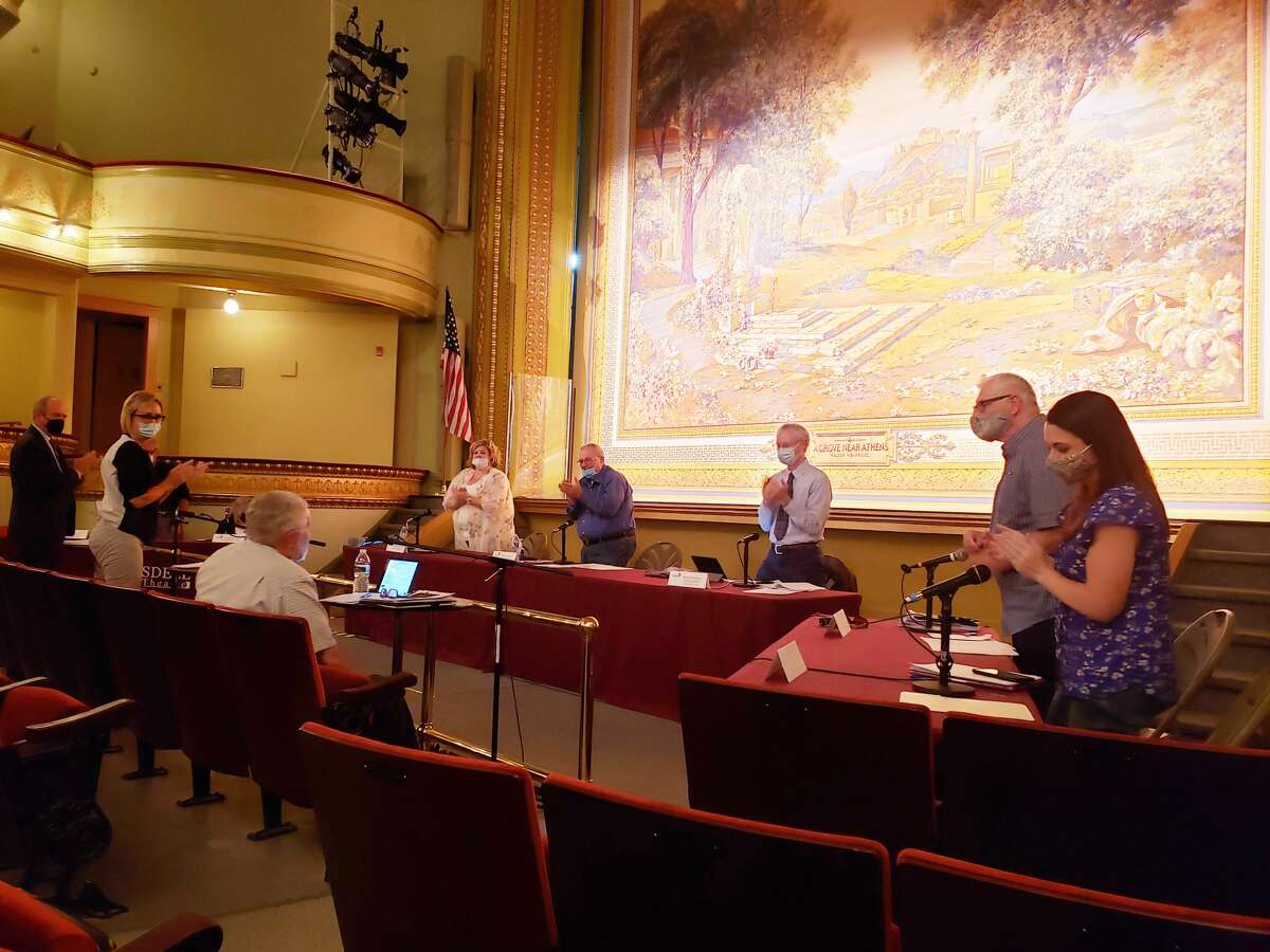 Manistee City Manager Thad Taylor received a standing ovation after council read a resolution of gratitude toward him on Tuesday. Each council member and many city staff also thanked Taylor for his work and friendship.