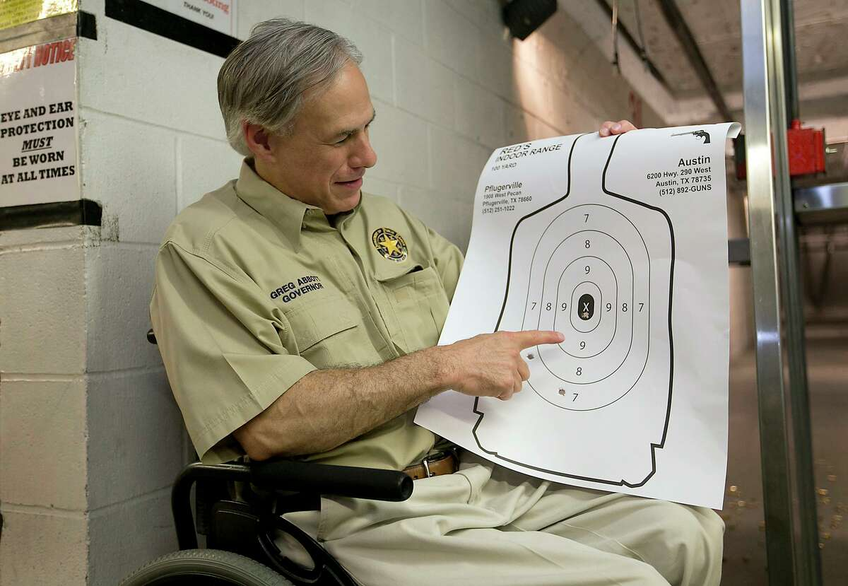 Texas Gov. Greg Abbott displays his marksmenship at Red's Indoor Range in Pfulgerville, Texas, Saturday, June 13, 2015. Abbott stopped at the gun range to sign into law bills letting Texans carry concealed handguns on college campuses and openly carry them virtually everywhere else. (Ralph Barrera/Austin American-Statesman via AP) AUSTIN CHRONICLE OUT, COMMUNITY IMPACT OUT, INTERNET AND TV MUST CREDIT PHOTOGRAPHER AND STATESMAN.COM, MAGS OUT