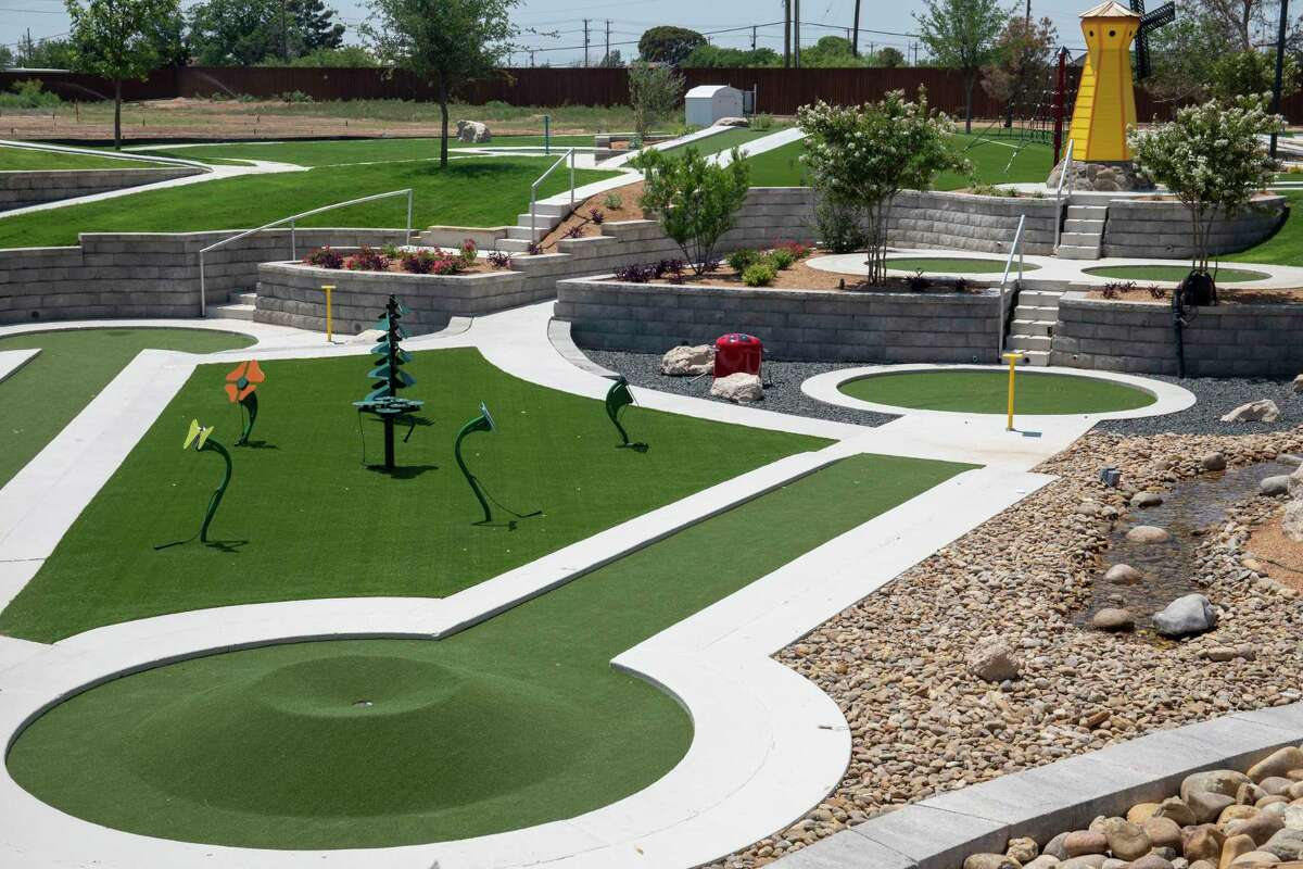 """The dreaded """"Ant Hill"""" is seen in the bottom left with """"The Windmill"""" in the background Wednesday, June 16, 2021 at Green Acres Mini Golf. Jacy Lewis/Reporter-Telegram"""