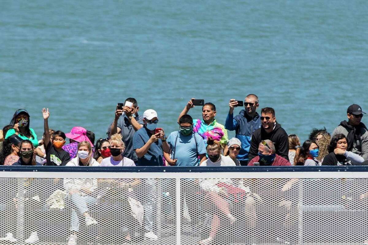 Tourists crowding onto a ferry to Alcatraz in San Francisco Tuesday as the state reopened.