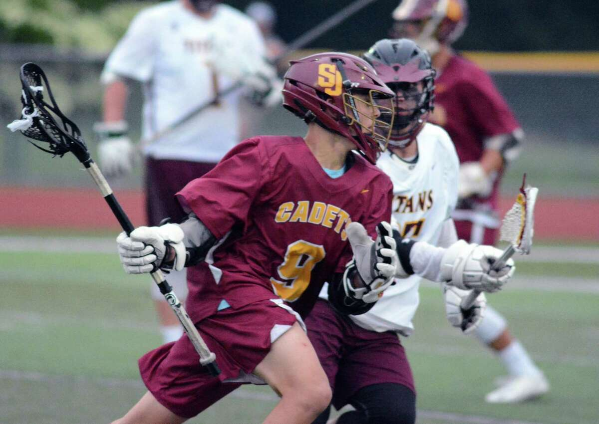 St. Jospeh's Eric Burbank (9) is defended by Sheehan's Justin Williams (16) during the CIAC Class S boys lacrosse semifinals on Wednesday, June 5, 2019 in Cheshire, Conn.