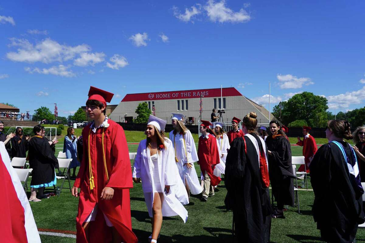"""""""Our New Canaan community succeeded in dealing with the historic pandemic because our residents and our students cared for each other. Our nation and our local communities need you to be kind and care for your neighbors and fellow citizens,"""" the first selectman told the graduates. High School Principal William Egan kept with the theme of resilience. """"Tough times don't last, but tough people do,"""" Egan said, complimenting the lot. He shared reasons why some """"people weather a storm much better than others,"""" saying gratitude is a key. """"We develop gratitude like a muscle,"""" Egan said. """"Consciously, cultivating an attitude of gratitude, builds up a sort of psychological immune system that can cushion us when we fall. There is scientific evidence that grateful people are more resilient to stress."""" Luizzi thanked his staff and faculty. He also talked about how Moynihan and him met every morning at 8 a.m. to coordinate town and school efforts. Graduates said the year was mixed. """"It was a mix of up and down,"""" Michael Rivas, Class of 2021, said it was a challenge, but he worked harder than before """"to keep my grades up"""" and was happy with the progress he made with piano, violin and school work. """"It was eclectic,"""" graduate Hannah Moore said. """"(There have been) been a lot of ups and downs, but it came together in the end to be something special."""" A """"great year,"""" graduate Lila Brennan said. The New Canaan High School String Nonet played the Beatles song """"Yesterday"""" at the ceremony. The Irish Blessing was sung by New Canaan High School choir members. The recession from Lambs to Rams: Tribute to Class of 2021 was composed by graduate William Haddad and mixed by fellow graduate Ian Rocha."""