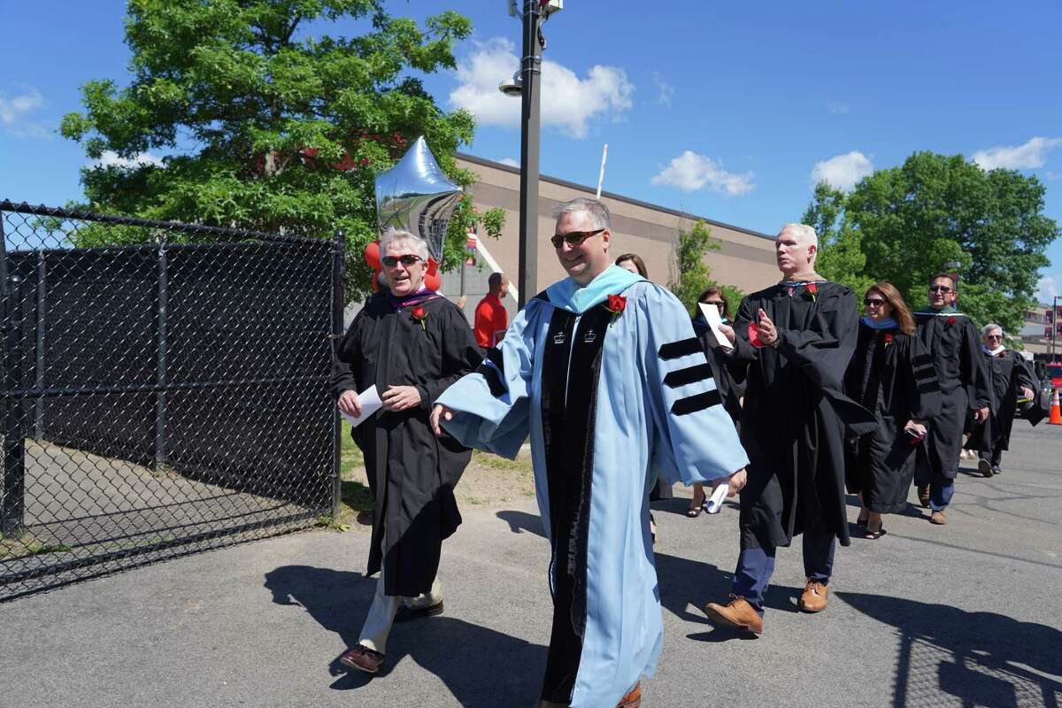 First Selectman Kevin Moynihan, left, and Superintendent Bryan Luizzi led the procession into the graduation for the Class of 2021 on June 16. New Canaan Principal William Egan followed close behind Luizzi.