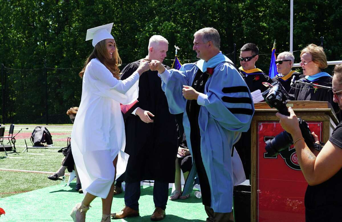Luizzi fist bumped Shannon Jordan, a member of the New Canaan Class of 2021 during the commencement ceremony.