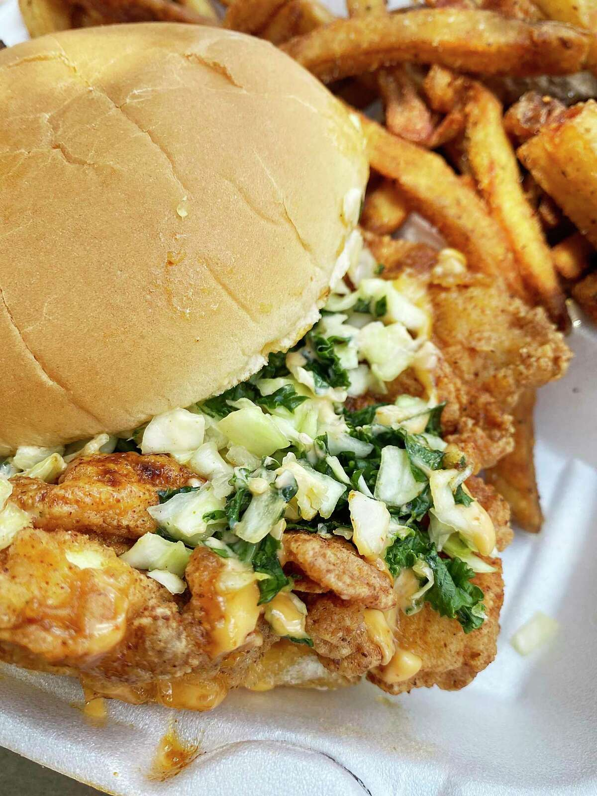 The Veg Head is a fried cauliflower sandwich with slaw, Bird Sauce and a side of fries at Chi Chi Birds Hot Chicken.