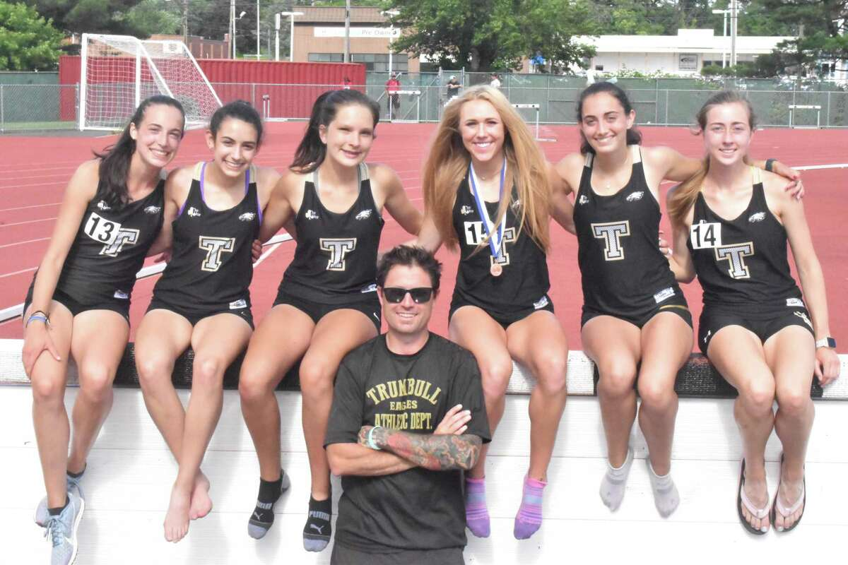 Calyn Carbone, Evelyn Marchand, Abigail Poplawski, head coach Jim McCaffrey, Kali Holden, Brenna Asaro and Ella Consla get together at the CIAC Steeplechase competition.