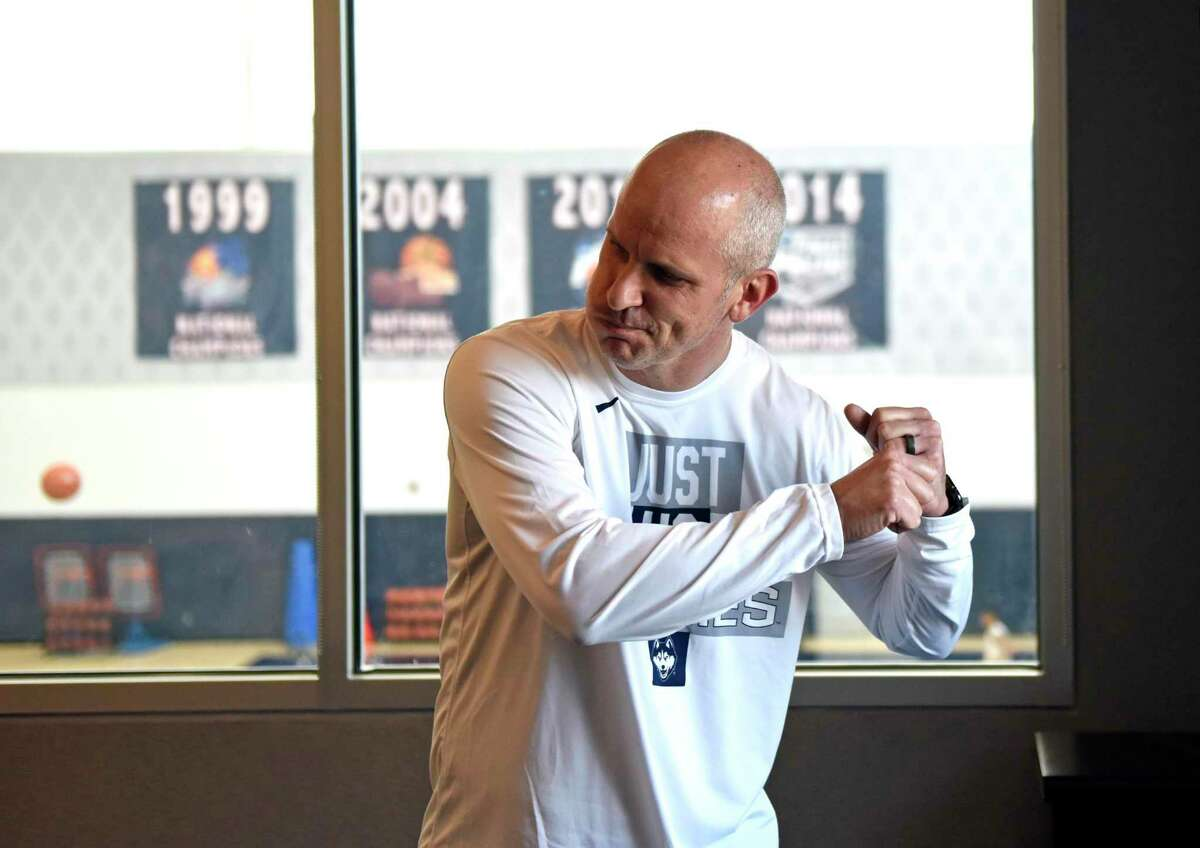 UConn men's basketball coach Dan Hurley does an impression of baseball player George Brettin his office at the Werth Family UConn Basketball Champions Center on the UConn main campus in Storrs, Conn. Wednesday, June 9, 2021.