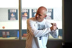 UConn men's basketball coach Dan Hurley does an impression of baseball player George Brett in his office at the Werth Family UConn Basketball Champions Center on the UConn main campus in Storrs, Conn. Wednesday, June 9, 2021.