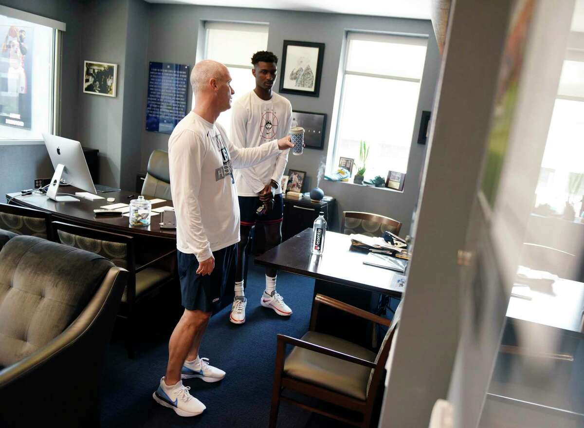 UConn men's basketball coach Dan Hurley meets for the first time with freshman Samson Johnson before practice at the Werth Family UConn Basketball Champions Center on the UConn main campus in Storrs, Conn. Wednesday, June 9, 2021.