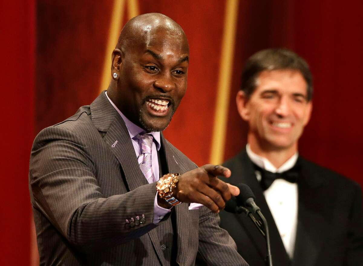 Inductee Gary Payton, left, speaks during the enshrinement ceremony for the 2013 class of the Naismith Memorial Basketball Hall of Fame as Hall-of-Famer John Stockton, right, looks on at Symphony Hall in Springfield, Mass., Sunday, Sept. 8, 2013. (AP Photo/Steven Senne)