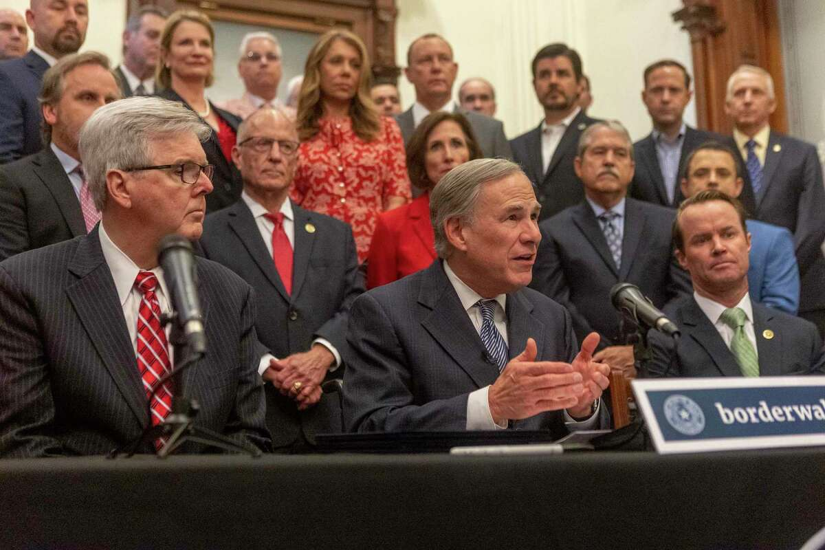 Lt. Governor Dan Patrick, left, Gov. Greg Abbott and House Speaker Dade Phelan announce a plan for Texas to add new fencing along the Mexican border during a press at the Texas State Capitol, Wednesday, June 16, 2021. (Stephen Spillman / for Express-News)