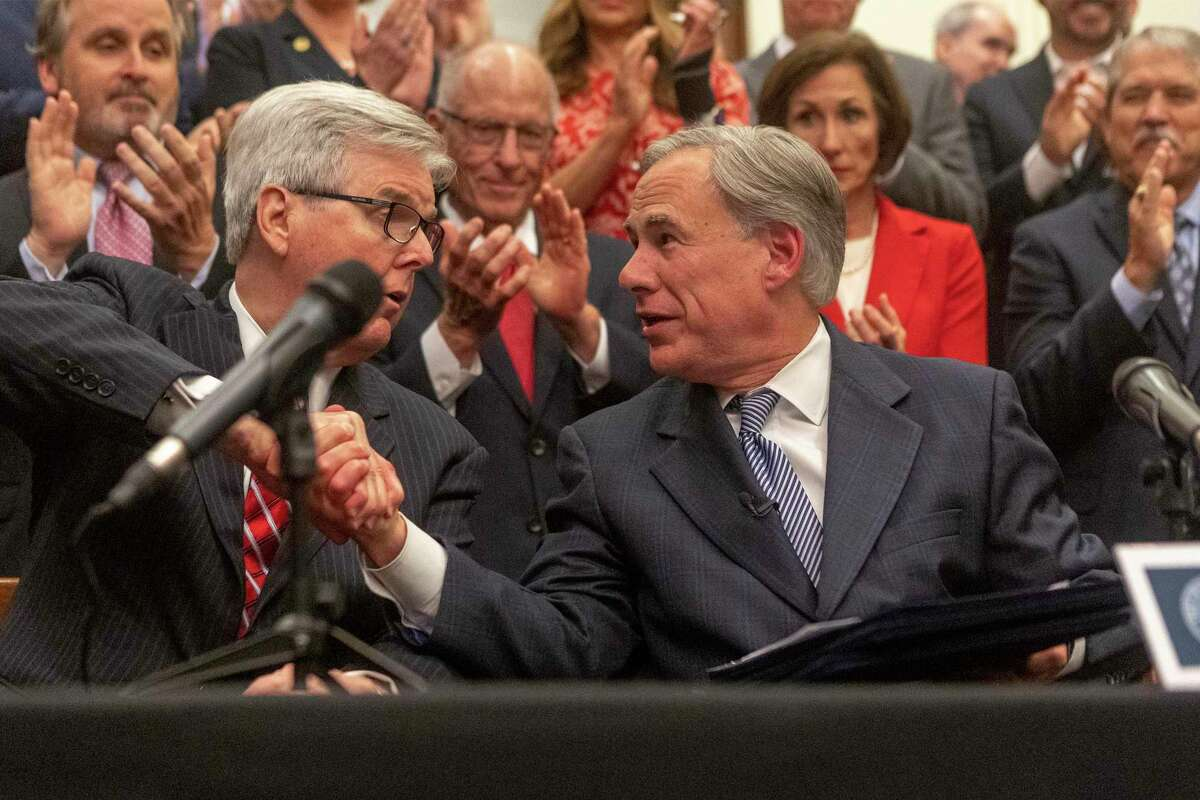 Lt. Governor Dan Patrick, left, and Gov. Greg Abbott announce a plan for Texas to add new fencing along the Mexican border during a press at the Texas State Capitol, Wednesday, June 16, 2021. (Stephen Spillman / for Express-News)
