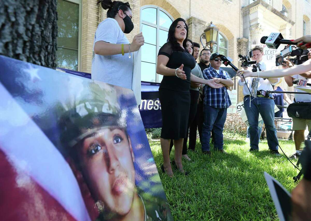 Attorney Natalie Khawam (center) addresses the media before a hearing as family and supporters of slain Army Spc. Vanessa Guillén appear at a hearing in Waco, Texas on Wednesday, June 16, 2021 for Cecily Aguilar, the girlfriend of Guillén's suspected killer, who asked a judge to suppress her confession to police that she helped hide the late Houston soldier's body after her boyfriend bludgeoned her to death. A judge rejected her motion to suppress evidence of her police statement from a potential jury. She also has a pending motion to dismiss the entire indictment. While the hearing was underway, family members and supporters stood outside the courthouse and chanted for justice for Guillén.