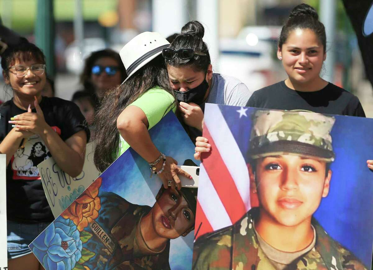 Lupe Guillén (center), whose sister was slain while on duty at Fort Hood in 2020, appears emotional as she gets a hug from supporter Larissa Martinez of San Antonio after learning outcome of a federal hearing in Waco, Texas on Wednesday, June 16, 2021 for Cecily Aguilar, the girlfriend of Guillén's suspected killer, who asked a judge to suppress her confession to police that she helped hide the late Houston soldier's body after her boyfriend bludgeoned her to death. A judge rejected her motion to suppress evidence of her police statement from a potential jury. She also has a pending motion to dismiss the entire indictment. While the hearing was underway, family members and supporters stood outside the courthouse and chanted for justice for Guillén. Aguilar's requests were denied.
