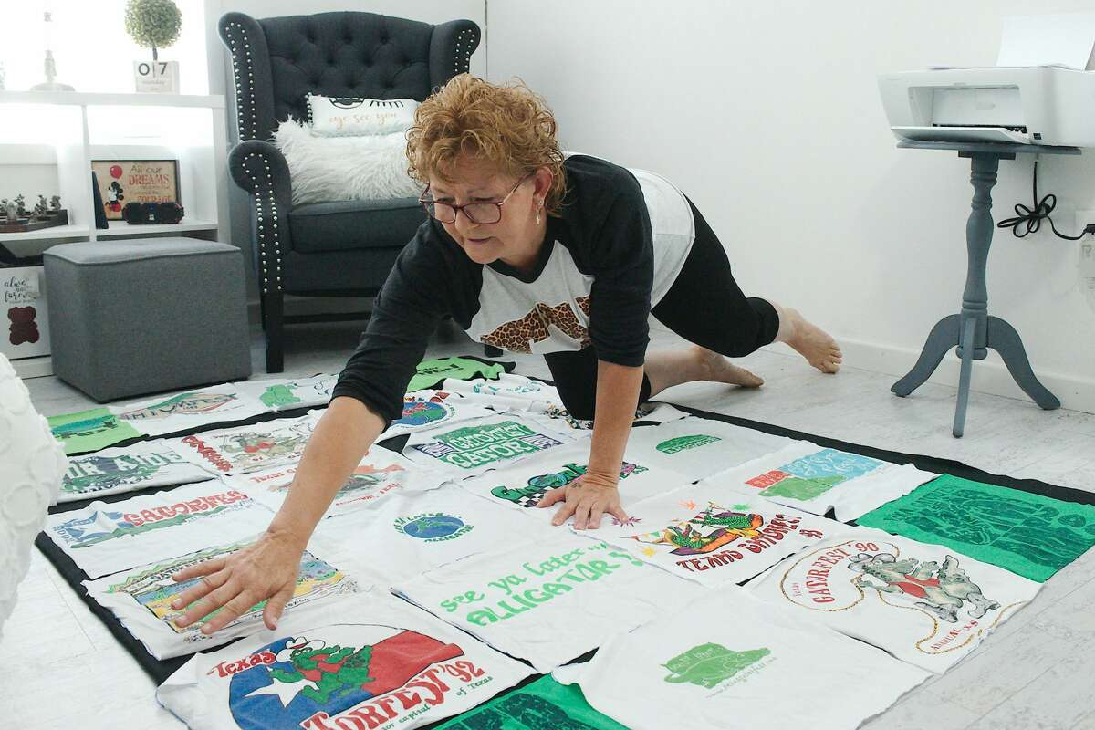 Crafter Heidi Schubert lays out individual T-shirt squares to form a blanket that she will sew for a customer.