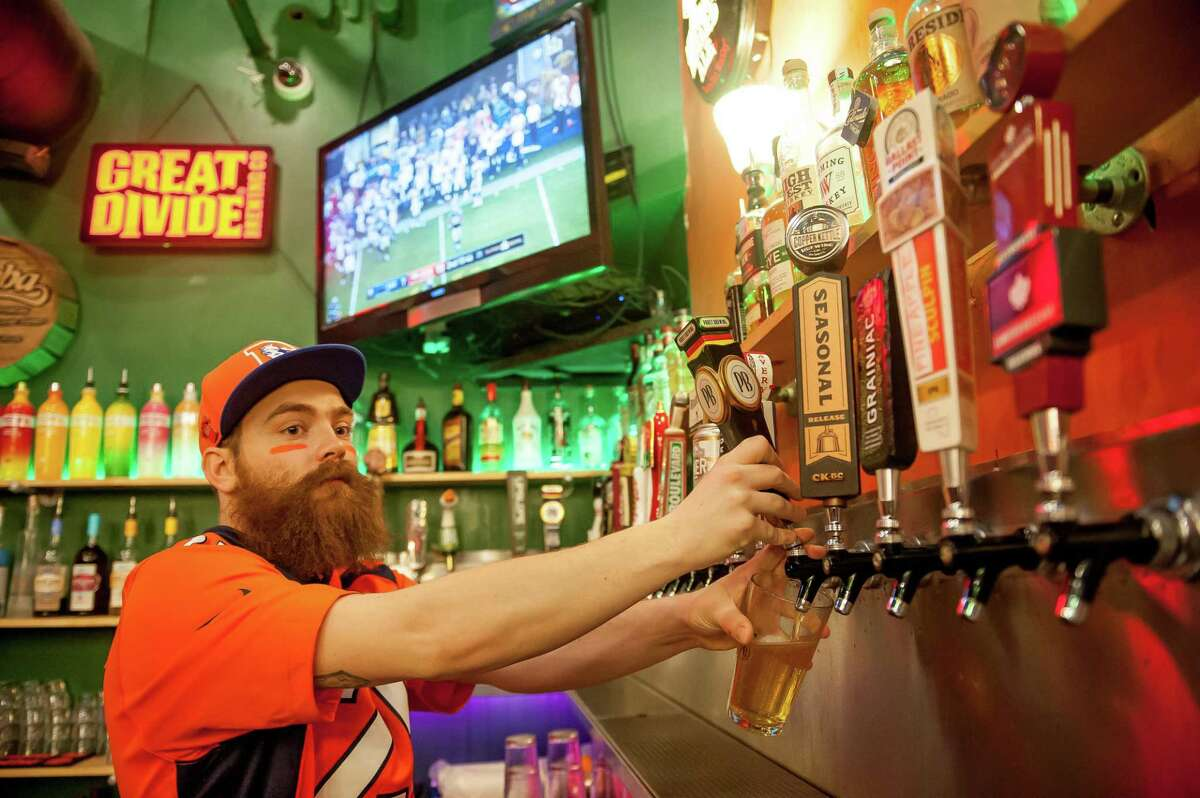 A bartender pours beer at a Cheba Hut location in Denver.