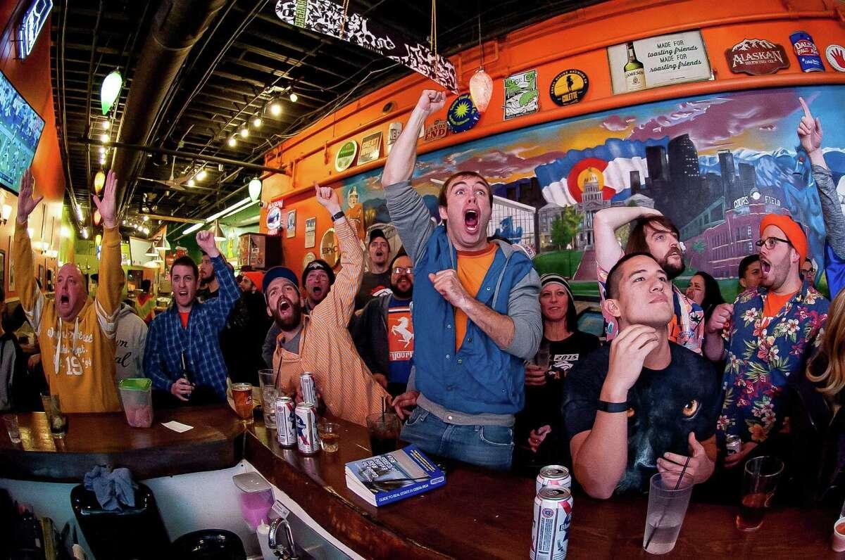 Denver Broncos fans watch Super Bowl 50 at a Cheba Hut in Denver.