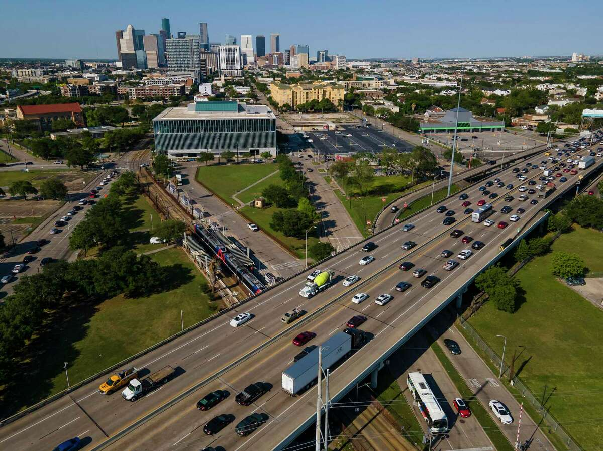 People move through the Wheeler Transit Center on April 21, 2021, in Houston. Wheeler Transit Center, where the Red Line light rail and various bus routes cross is a major hub along a planned University bus rapid transit line that could proceed next week.