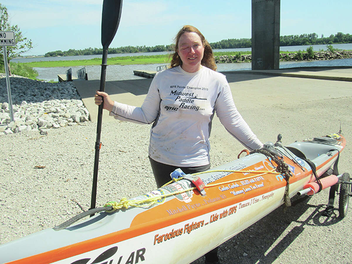 Competitive kayaker Traci Lynn Martin of Kansas City, Missouri, stands beside her kayak during a break from her quest to set a world record for the fastest time a solo female kayaker travels the length of the Mississippi River.