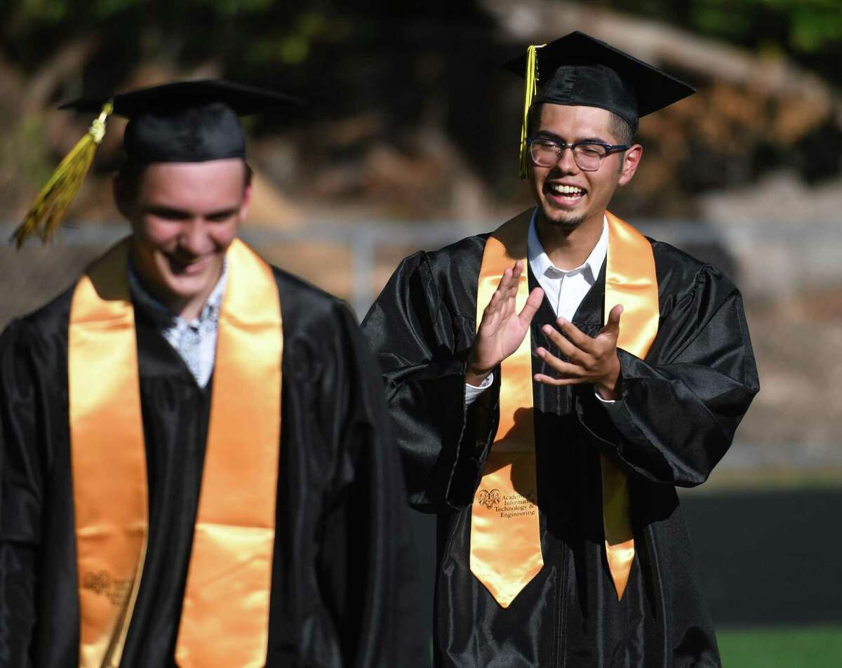 Luzdary Hoyos Dominguez claps as classmate Skylar Heiligenthaler has his name called during the Academy of Information Technology & Engineering (AITE) 2020-2021 commencement ceremony at the AITE campus in Stamford, Conn. Wednesday, June 16, 2021.