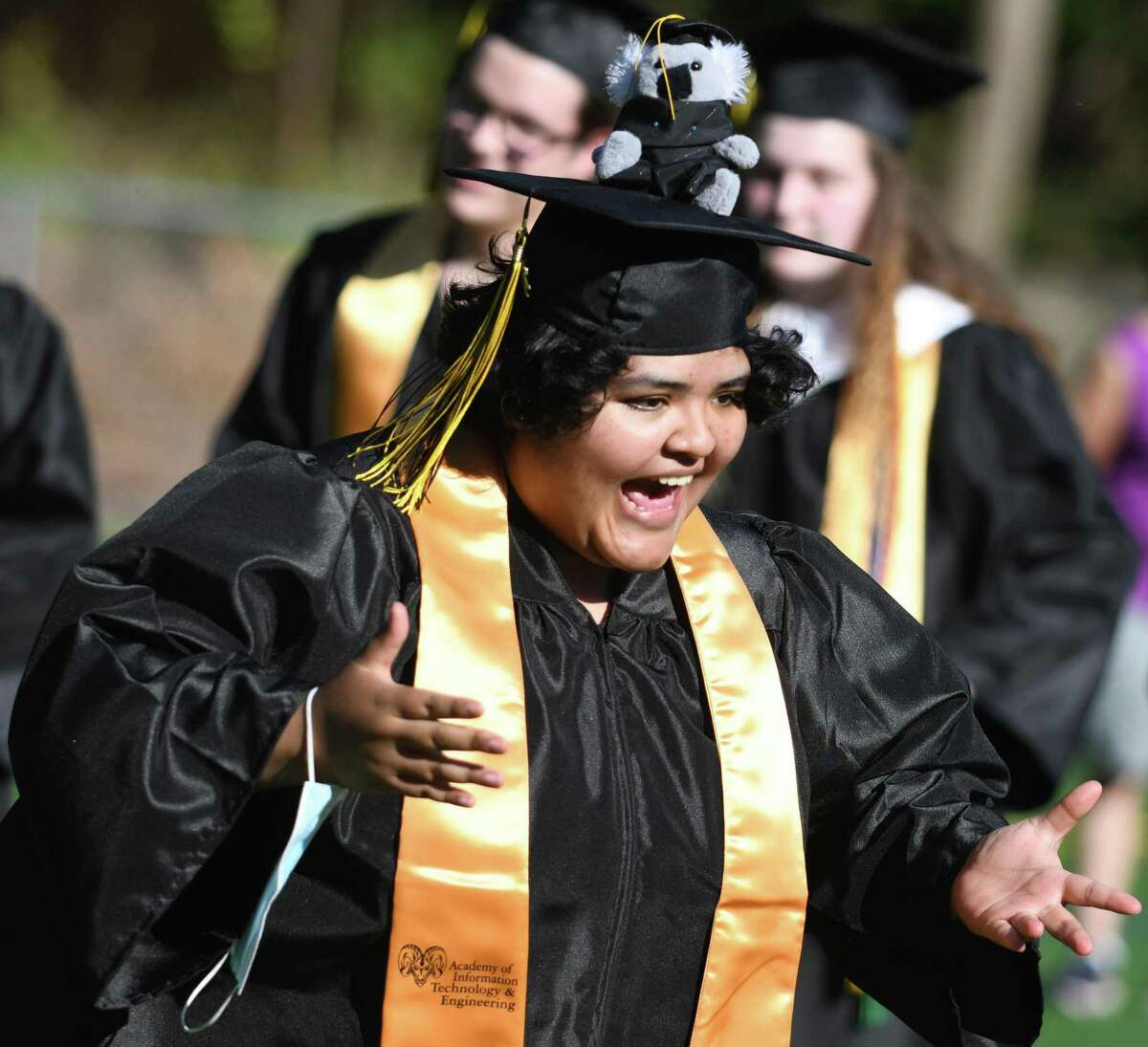 Madelyne Fajardo Polo receives her diploma at the Academy of Information Technology & Engineering (AITE) 2020-2021 commencement ceremony at the AITE campus in Stamford, Conn. Wednesday, June 16, 2021.