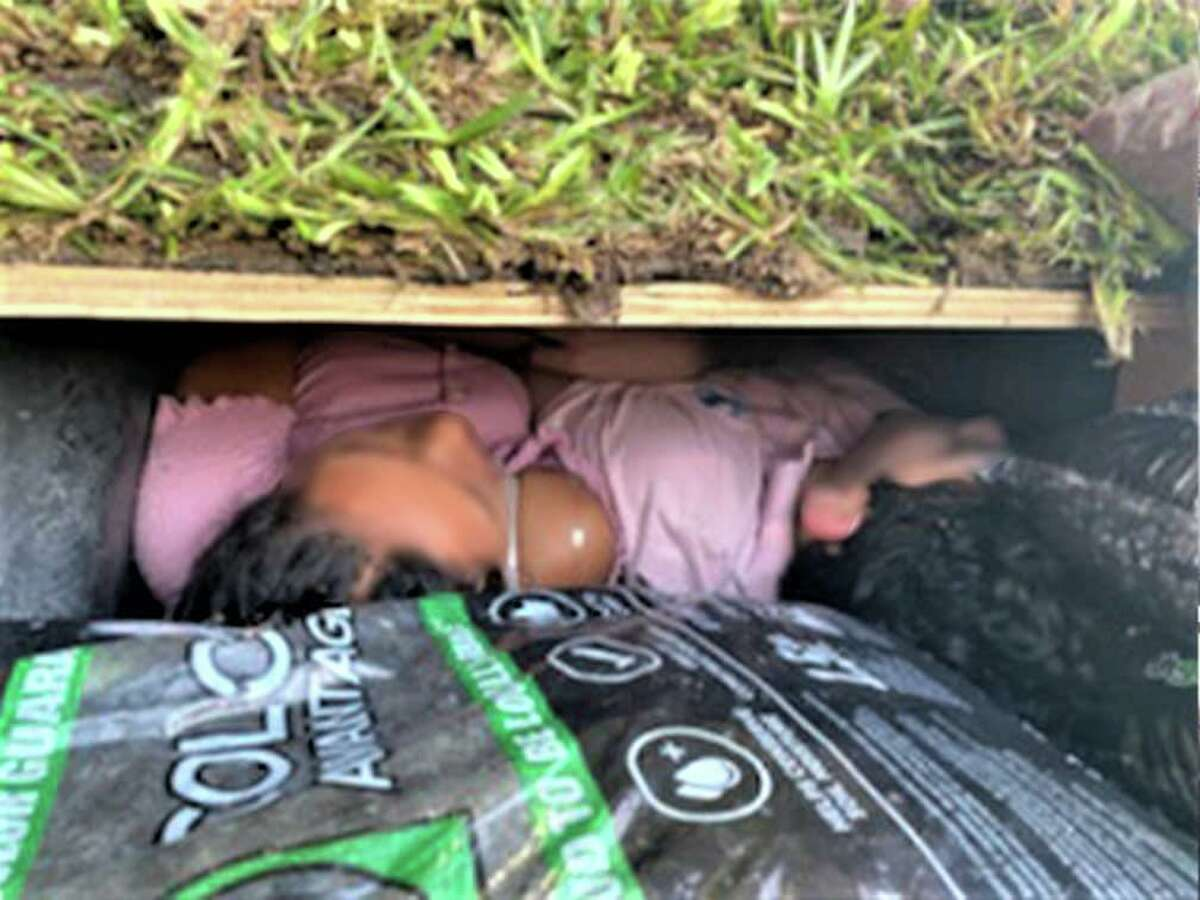 Federal authorities said they discovered four migrants under pallets of grass.