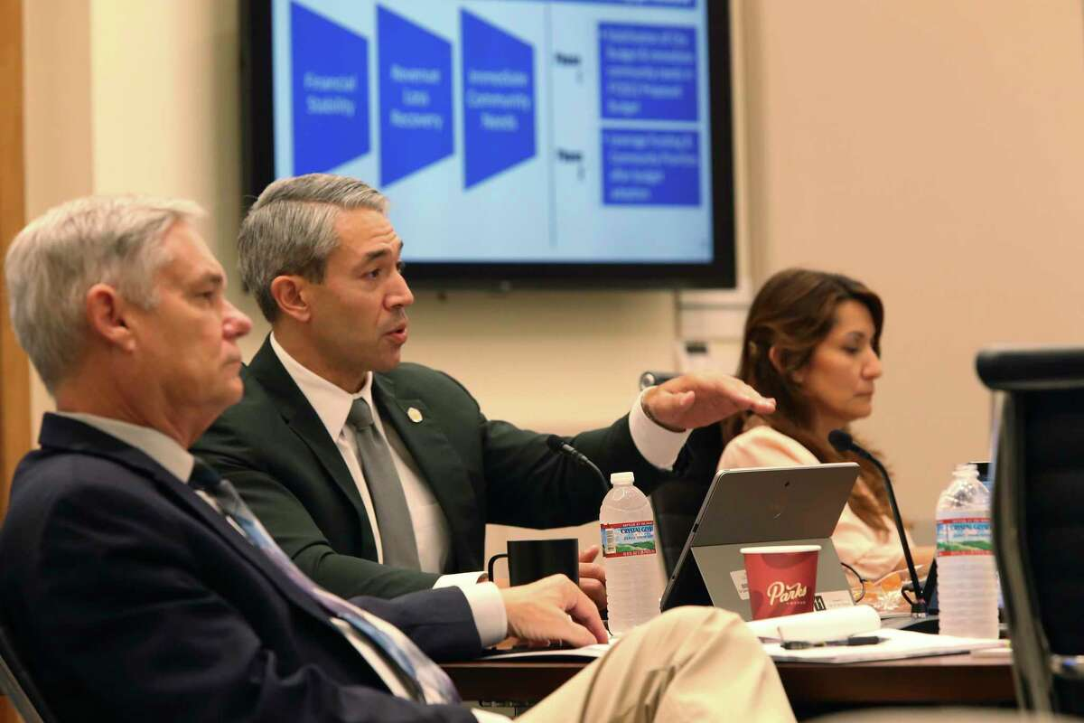 San Antonio Mayor Ron Nirenberg speaks as the city council is briefed on an early picture for next year's budget during a meeting with City Manager Erik Walsh and city staff on June 16. On the left is City Council District 10 member Clayton Perry and on the right is District 6 member Melissa Cabello Havrda.