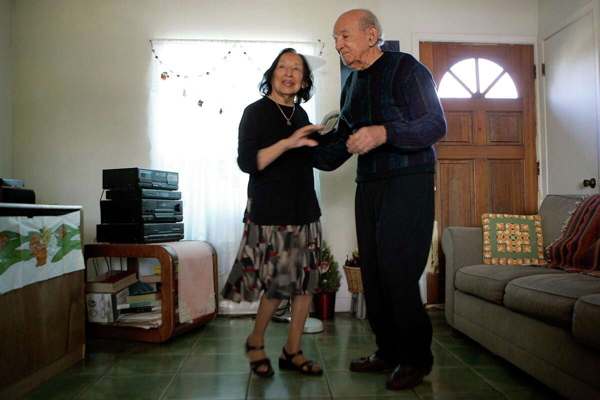Isabel and Enrique Sanchez dance in the living room of their San Antonio home on Jan. 12, 2009. Isabel Sanchez died on Monday, June 14, 2021, a few weeks shy of celebrating her 98th birthday.