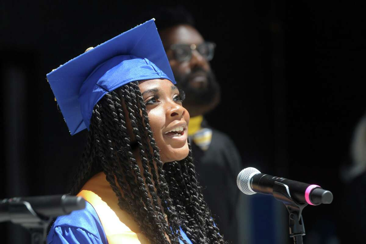 Jasade Ashley sings the National Anthem during graduation for the Warren Harding High School Class of 2021, at the Hartford Healthcare Amphitheater in Bridgeport, Conn. June 16, 2021.