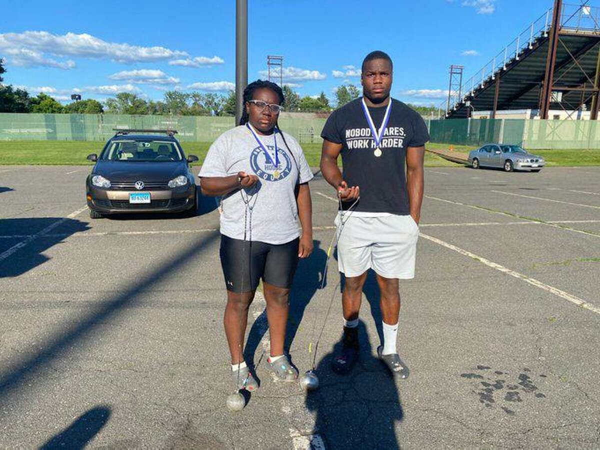 Leah Moore of Hillhouse wins the girls hammer throw and Hillhouse's Gary Moore Jr. takes second in the boys hammer throw on Wednesday at Willow Brook Park in New Britain.