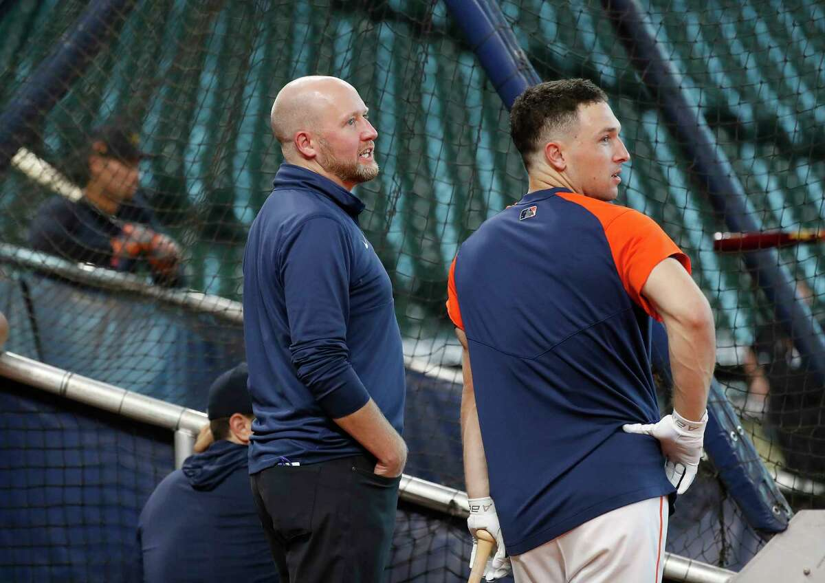 Houston Astros GM James Click chats with Alex Bregman during batting practice before the start of an MLB baseball game at Minute Maid Park, Wednesday, June 16, 2021.