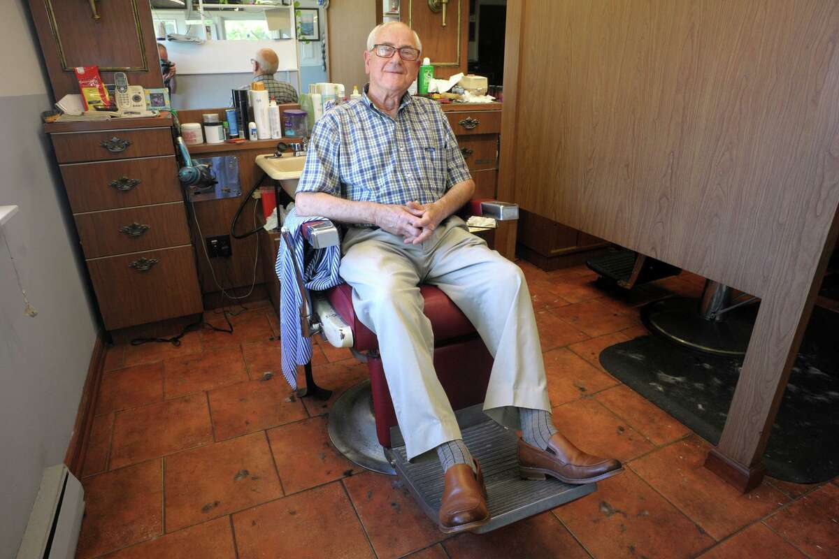 Aldo Melchionno poses at Colonial Barber Shop in Fairfield on June 15.