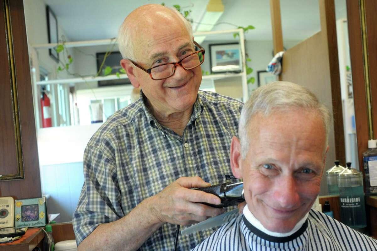 Aldo Melchionno cuts Ira Nachem's hair at Colonial Barber Shop, in Fairfield, Conn. June 15, 2021.