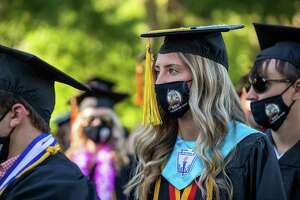 Shelton High School graduate Caitlin McNeil walks with the Class of 2021 during graduation.