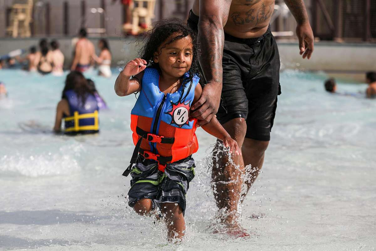 Keanu Velasquez, 3, runs in the pool with his father, Chris, while at South Bay Shores water park at California?•s Great America in Santa Clara, Calif. on Wednesday, June 16, 2021. The water park opened on June 5 after having to post pone their opening day last year due to the pandemic. The water park includes slides, a lazy river and wave pool offering solace to visitors beating the heat after the National Weather Service is issuing heat warnings for most of the Bay Area and surrounding counties for the next several days.