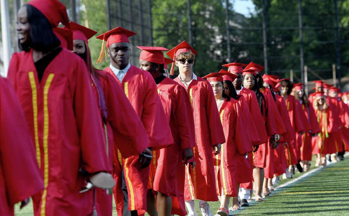 Seniors walk in a procession to their seats at the start of Wednesday's graduation. Stratford High School Class of 2021 holds its graduation ceremony at Penders Field at Longbrook Park in Stratford Wednesday, June 16, 2021.