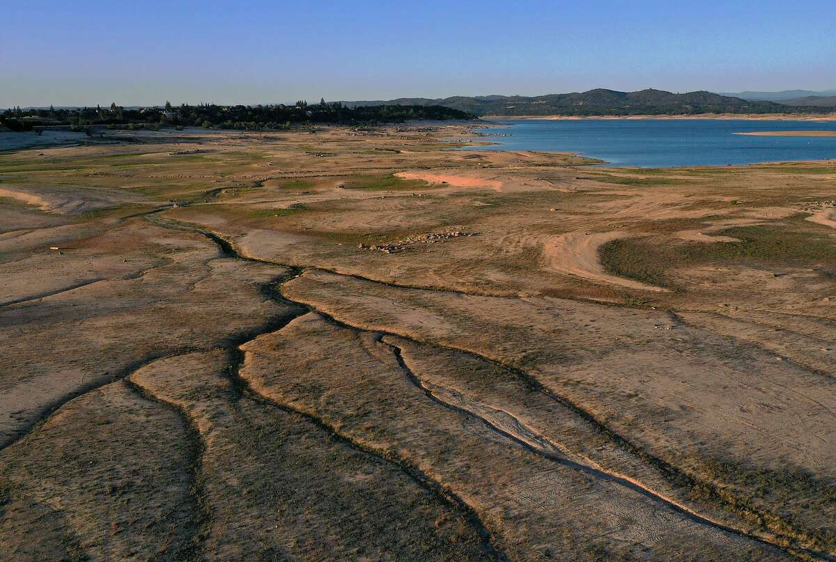 An aerial view of the Sierra foothills reservoir Folsom Lake, where surveyors discovered the remnants of a 1986 plane crash. The reservoir, shown here on May 10, 2021, is currently at 37 percent of normal capacity. (Justin Sullivan/Getty Images/TNS)