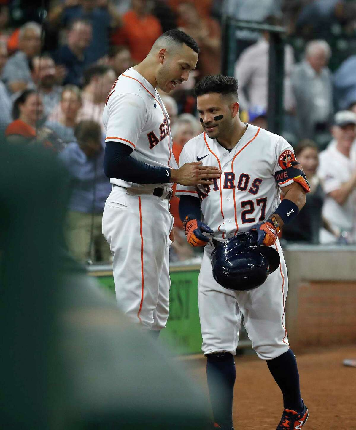 Houston Astros Jose Altuve (27) celebrates with Carlos Correa (1) after his solo home run during the eighth inning of an MLB baseball game at Minute Maid Park, Wednesday, June 16, 2021.