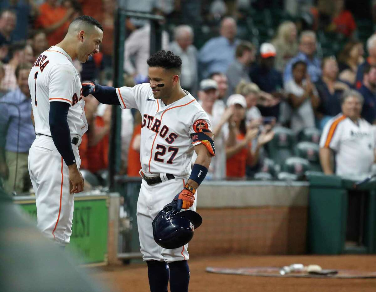 Jose Altuve (27) celebrates with Carlos Correa after hitting his second home run of Wednesday's game. Altuve had three homers in the Astros' two-game sweep of the Rangers.