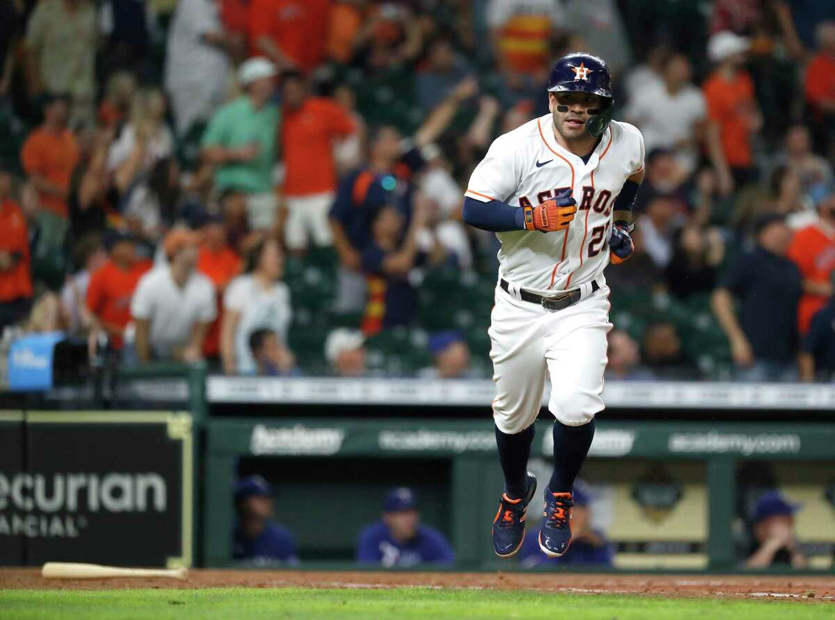 Jose Altuve begins the trot around the bases after his second home run Wednesday during the eighth inning of the Astros' 8-4 victory over the Rangers.