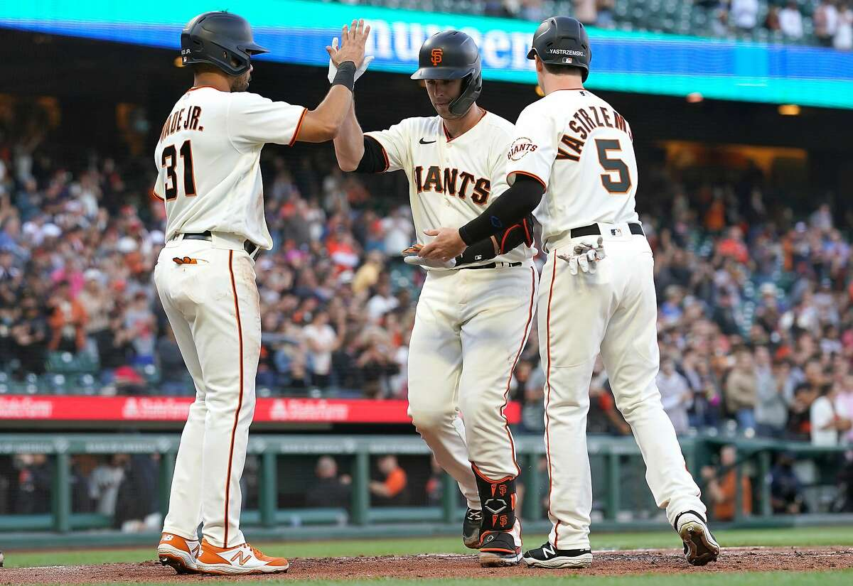 SAN FRANCISCO, CALIFORNIA - JUNE 16: Buster Posey #28 of the San Francisco Giants is congratulated by LaMonte Wade Jr #31 and Mike Yastrzemski #5 after hitting a three-run home run against the Arizona Diamondbacks in the bottom of the first inning at Oracle Park on June 16, 2021 in San Francisco, California. (Photo by Thearon W. Henderson/Getty Images)