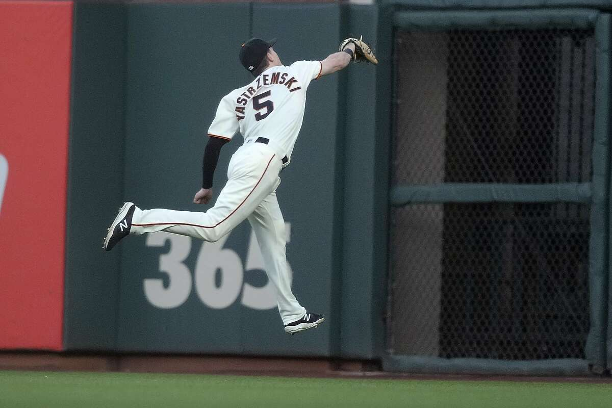 San Francisco Giants right fielder Mike Yastrzemski (5) makes a catch on a ball hit by Arizona Diamondbacks' Ketel Marte during the third inning of a baseball game Wednesday, June 16, 2021, in San Francisco. (AP Photo/Tony Avelar)