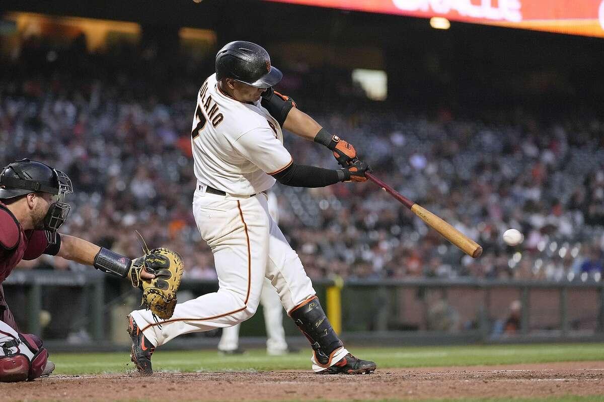 San Francisco Giants' Donovan Solano hits a two-run single against the Arizona Diamondbacks during the fourth inning of a baseball game Wednesday, June 16, 2021, in San Francisco. (AP Photo/Tony Avelar)