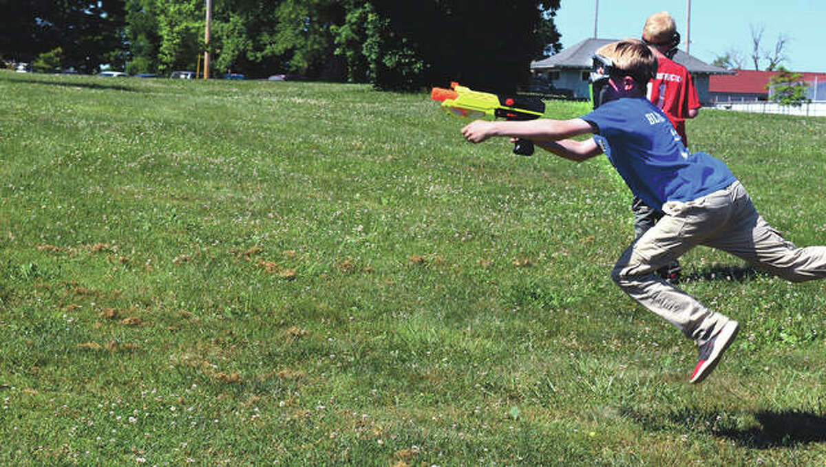 Drake Easterly, 11, the son of Adam Easterly of Mount Sterling and Heather Easterly of Jacksonville, plays with Nerf guns Wednesday at Nichols Park. He was joined in his game by his dad and his brother, Brennen.