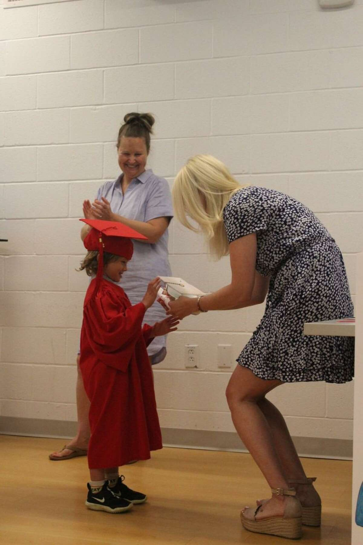 The New Canaan YMCA's Rainbow Station preschool Class of 2021, recently graduated from the school at the social services organization, on Friday, June 11. Rainbow Station Class of 2021 student graduate Riley Lynn accepting his diploma.