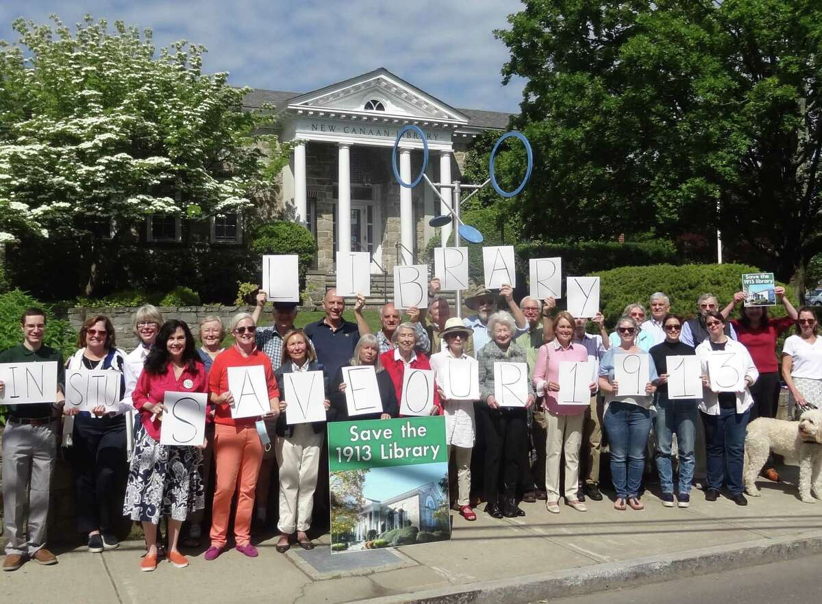 Town residents and volunteers gathered on a sunny Sunday, June 13 in New Canaan to show support for the saving and repurposing the original 1913 New Canaan Library building.