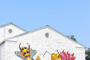Frankie Frieri, a tattoo artist at Three Roses Studio in Fairfield, painted the first mural at Fairfield Circle Inn.