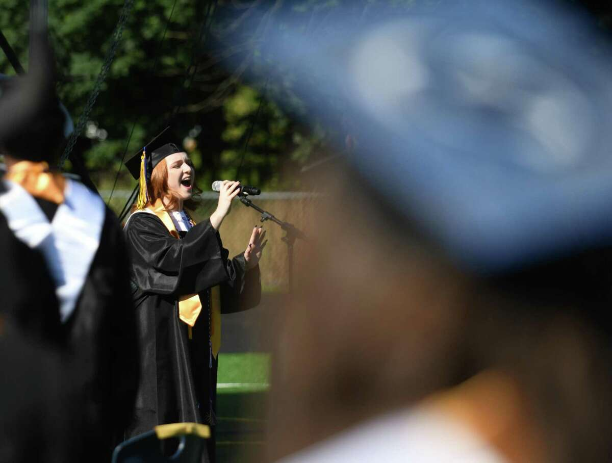 Student Council President Sophia Zanga sings the