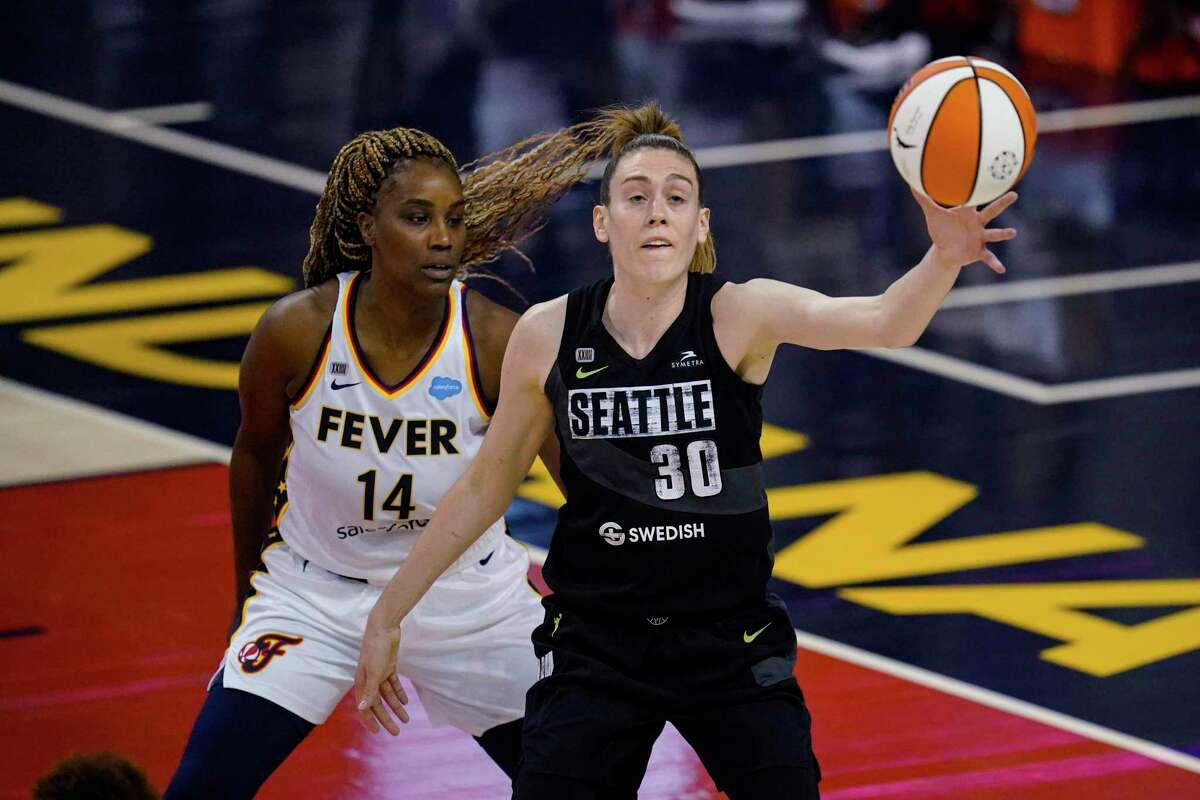 Seattle Storm forward Breanna Stewart gets a pass in front of Indiana Fever's Jantel Lavender during the first half of a WNBA basketball game in Indianapolis, Tuesday, June 15, 2021.